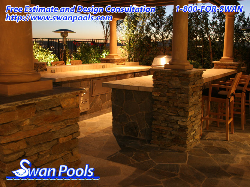 Custom U-shape, Outdoor Kitchen Barbeque with Tile top, Ledger Stone Veneer, and Custom Overhead ...
