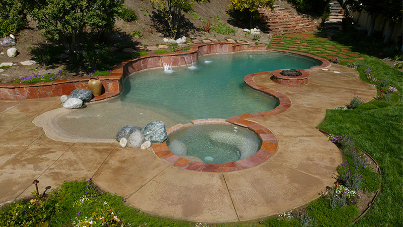 A desert oasis.  Swan Pools, a custom swimming pool builder, can create a relaxing and fun environment for those warm summer days.