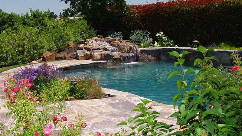Here, we are inspired by the classic swimming hole. Sculpted with generous quantities of genuine Red Mountain river rock and surrounded by irrigated planters, this Stockton property has the look, the feel and the sound of a riverside hollow - a pool that Huck Finn might have designed.