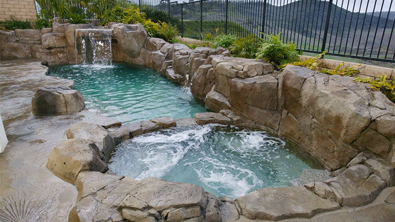 Swan Pools, a custom swimming pool company, excels in building rocky outcropings, fossilized concrete decking, large waterfalls, and bubbling water wisk you away to your very own natural hot spring.  Relax and let Mother Earth speak to you.
