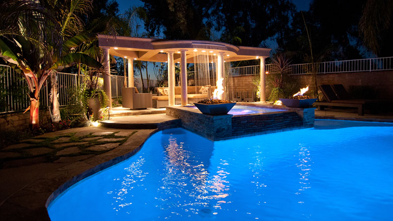 Swimming pool remodel with new built in spa.  Fire, pergola, and outdoor living in grand style, Laguna Hills, California.